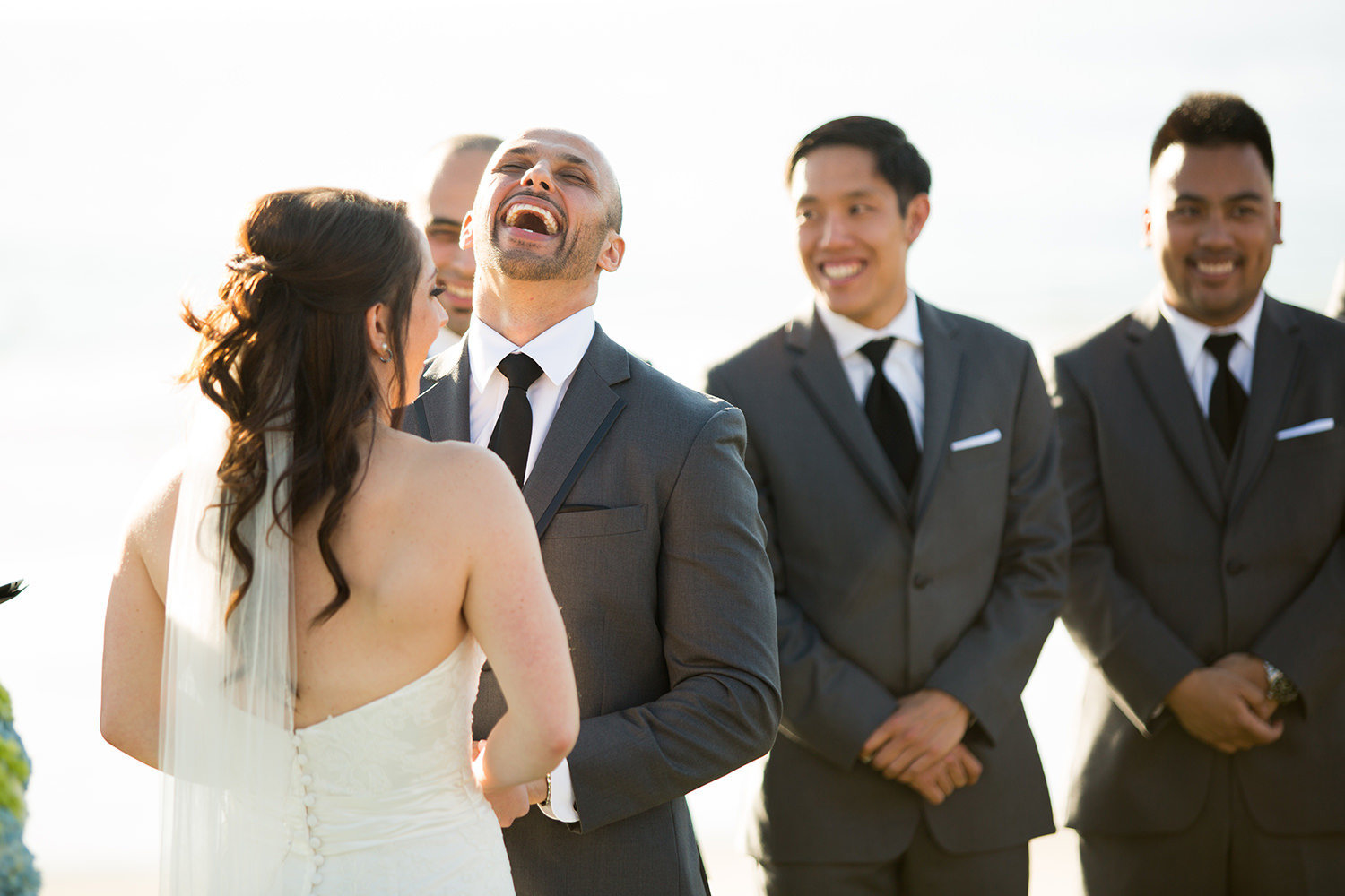 groom laughing at ceremony