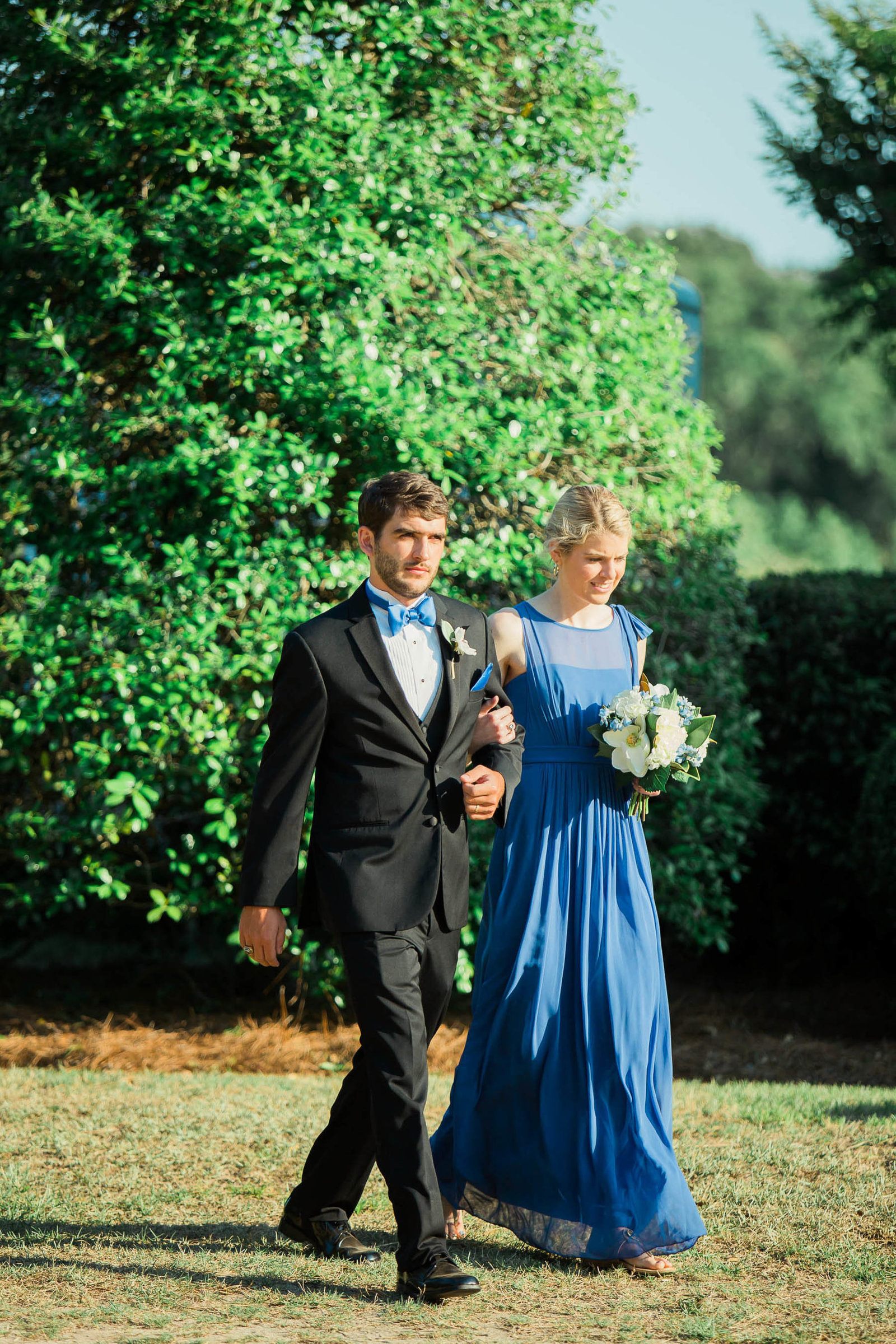 Groomsman and bridesmaid walks down the aisle, Oakland Plantation, Mt Pleasant, South Carolina