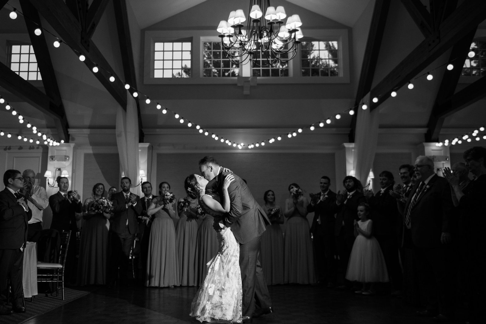 Couple shares their first dance at their Pavilion at Pinehills wedding in Plymouth MA