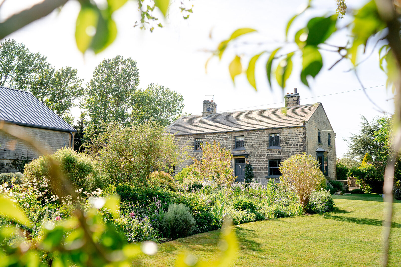 The garden and farmhouse at Wharfedale Grange Wedding Venue