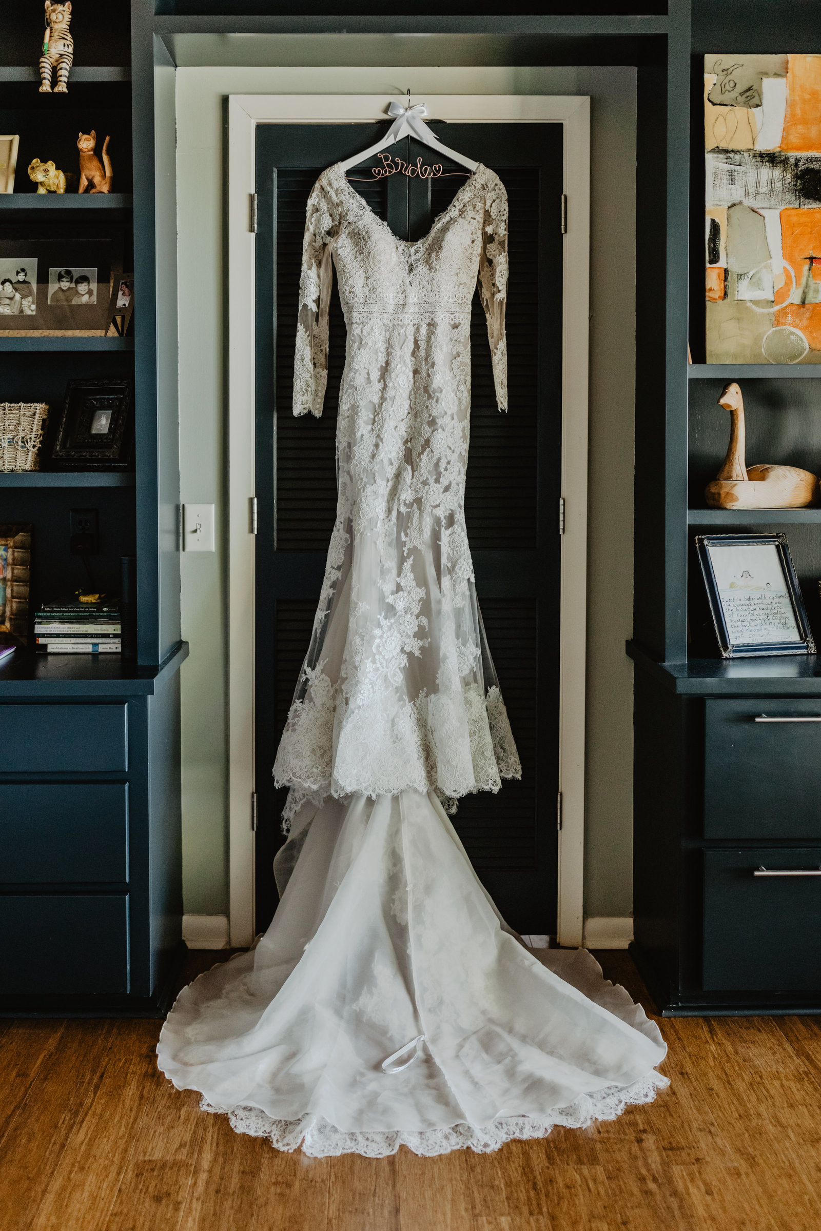 The lace and sleeves of this brides dress hanging in her moms house were a match for her private lake side ceremony in Arkansas