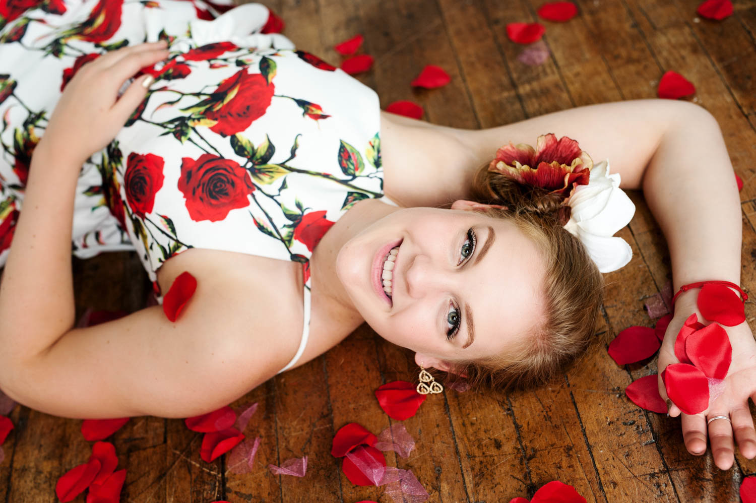 Studio senior picture of girl with flower petals