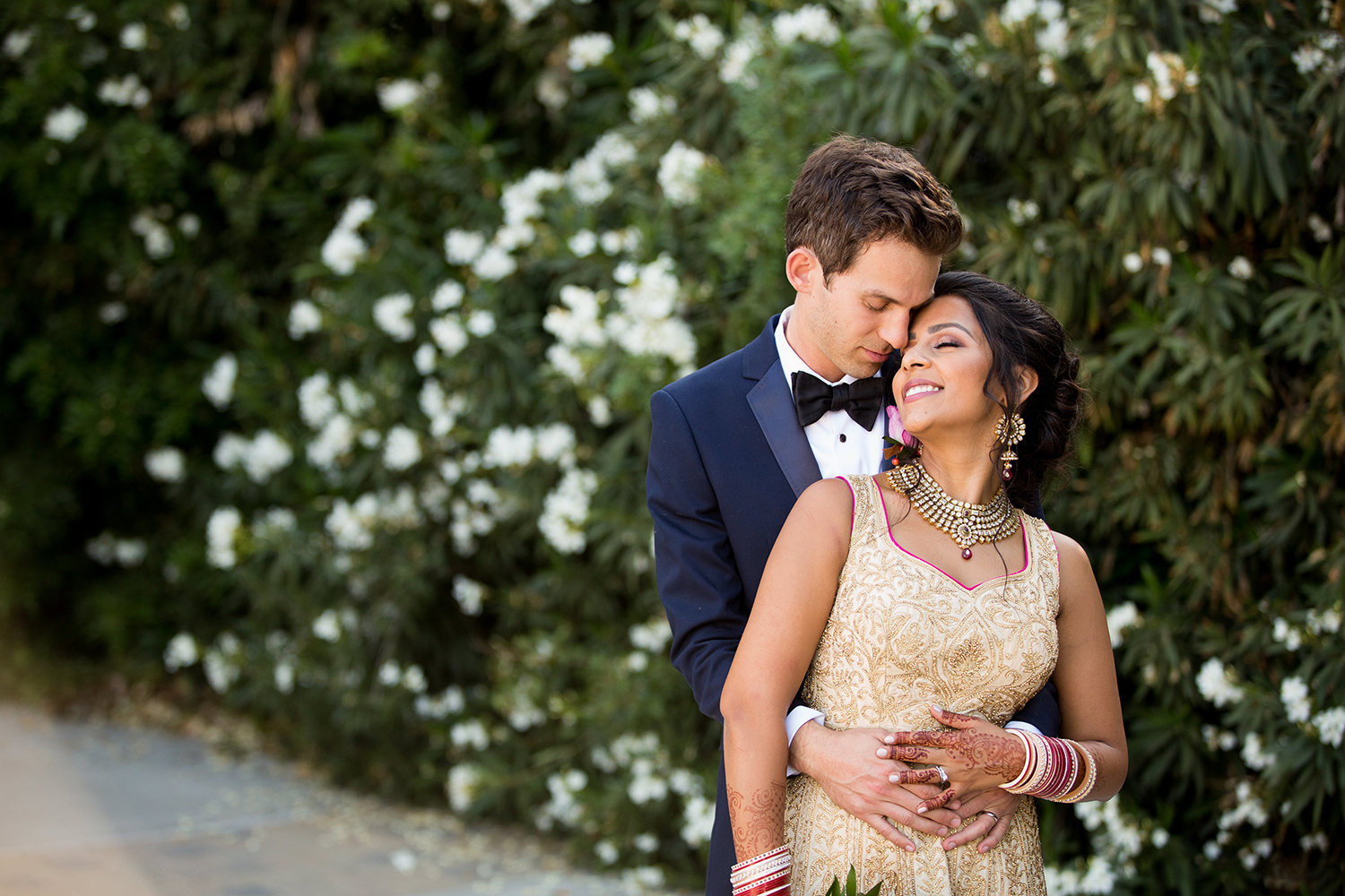 Loving embrace of Indian bride and groom at Twin Oaks Wedding Estate in San Diego