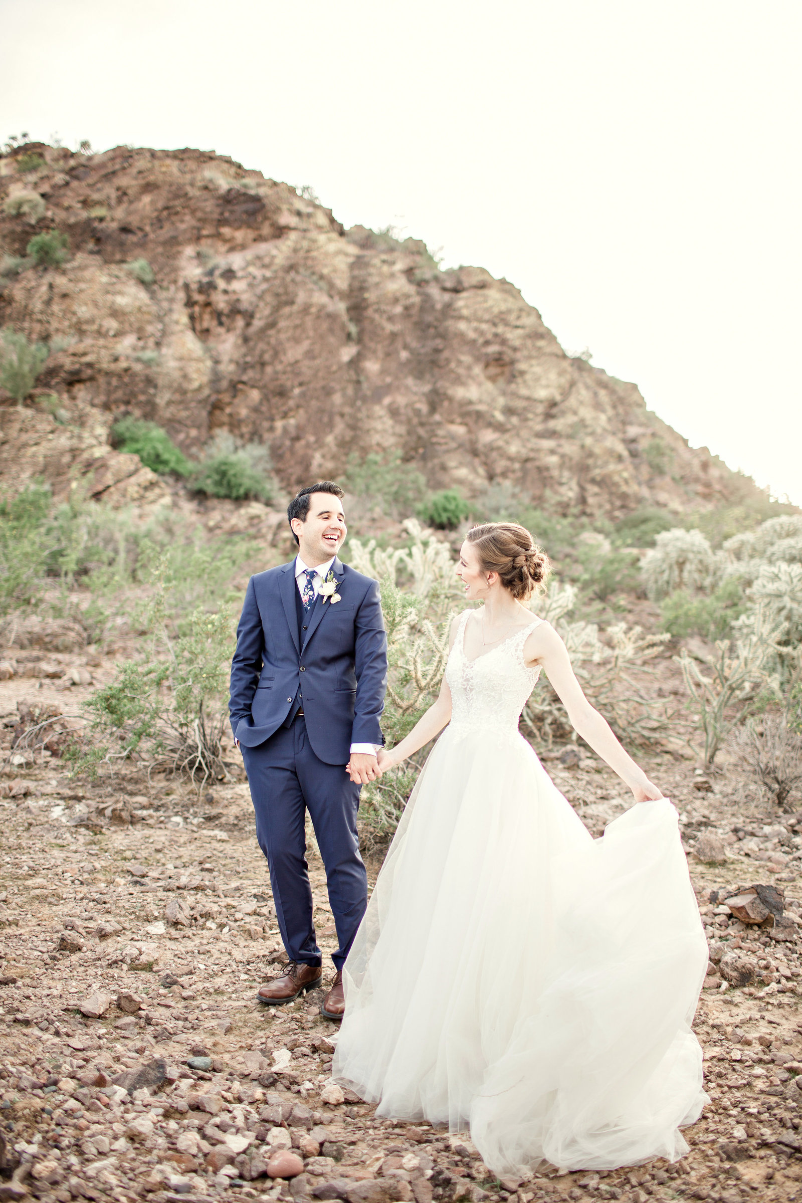Bride and Groom looking at each other with love in their eyes in Arizona desert.