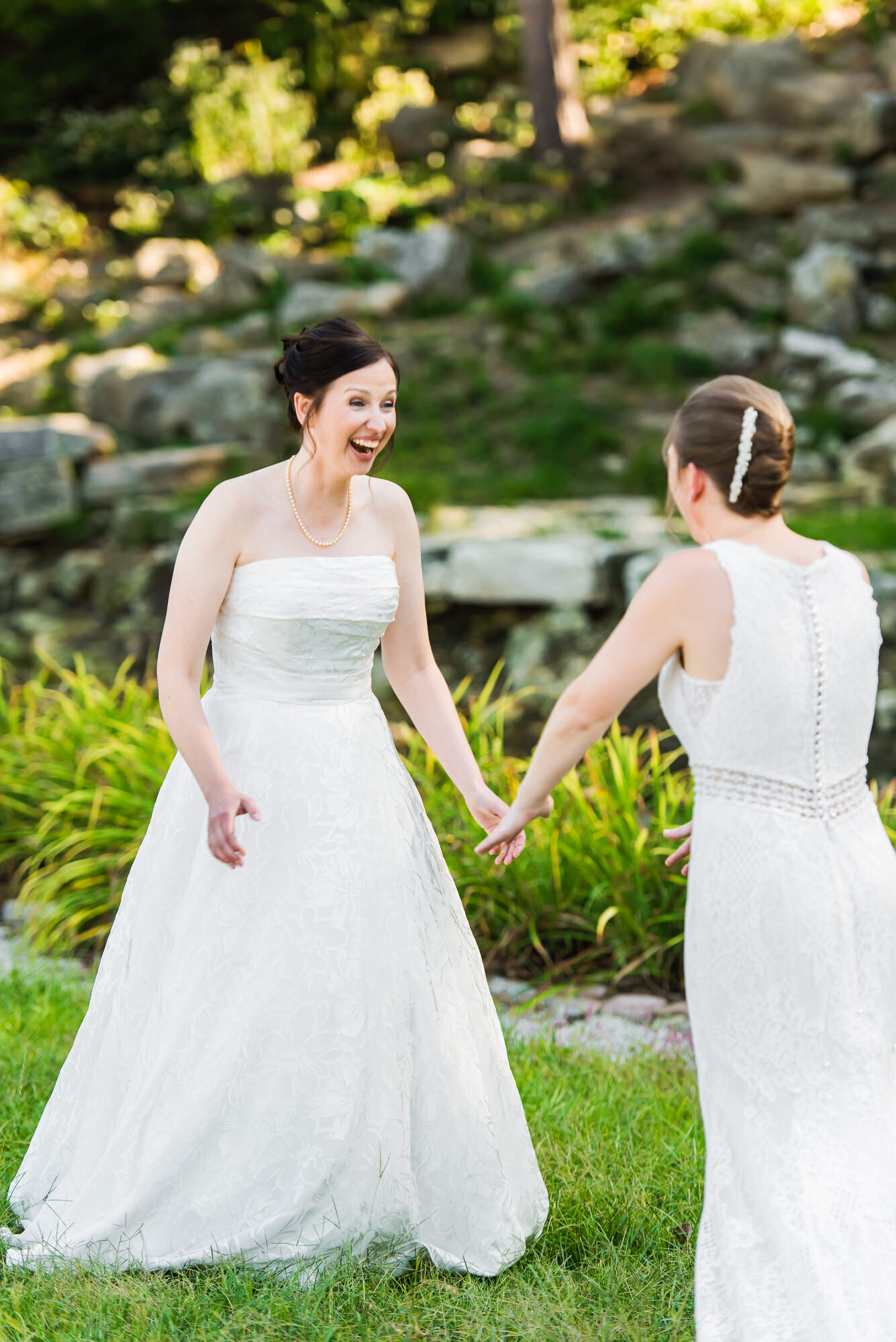 Excited brides see each other for the first time before their Forest Park Wedding