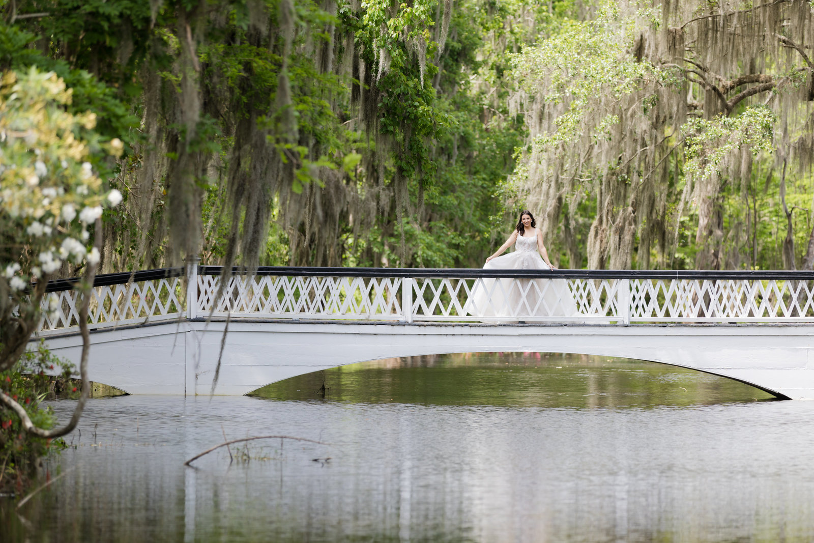 bride stands on beautiful white bridge