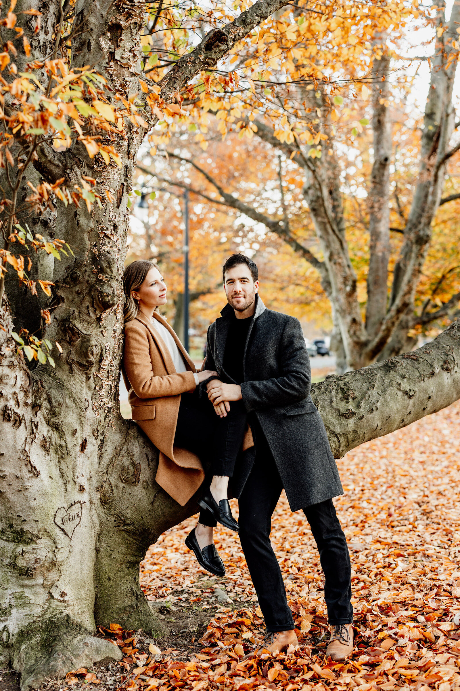 couple in colorful fall leaves