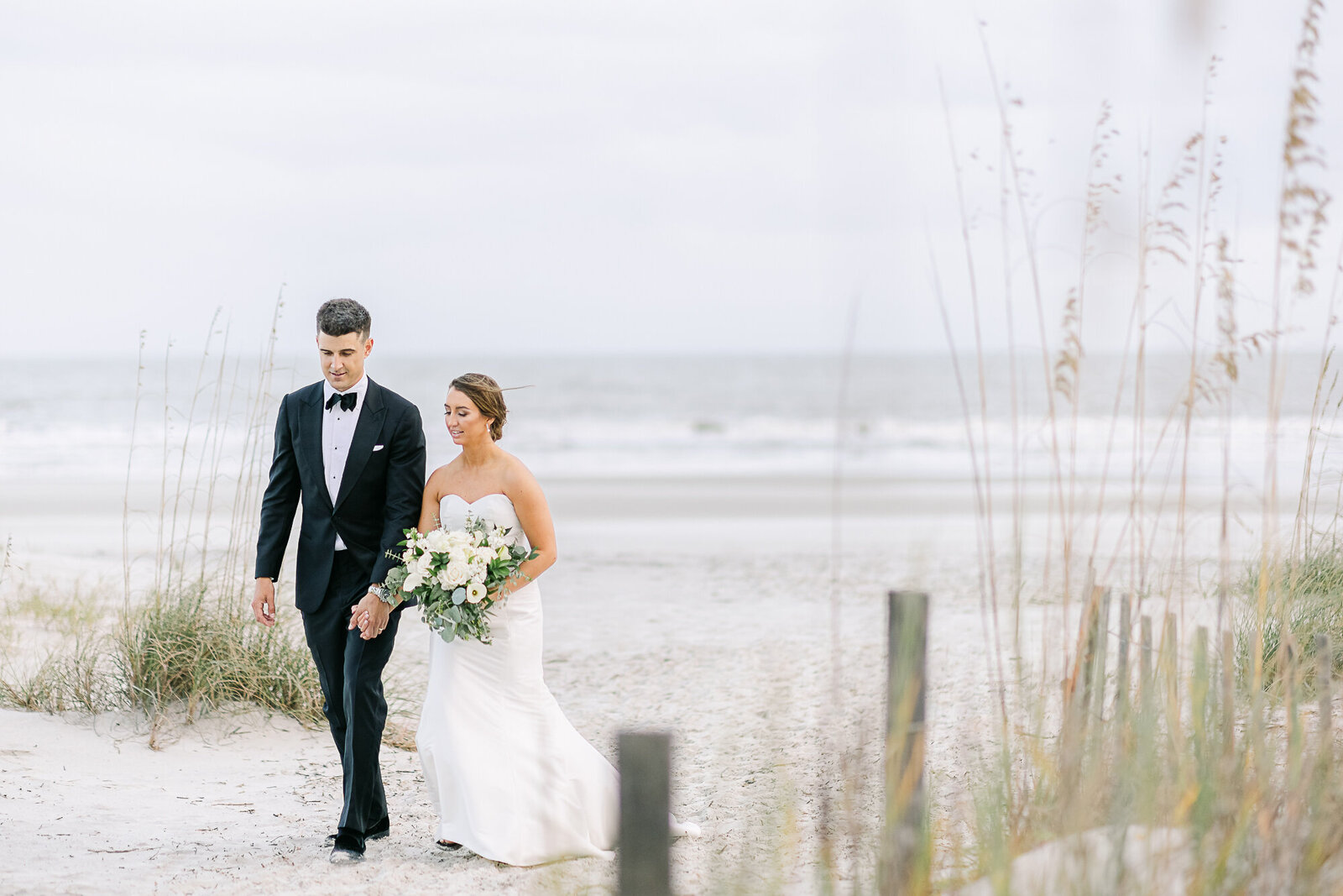 Bride and Groom Walk on the Beach in Hilton Head SC.