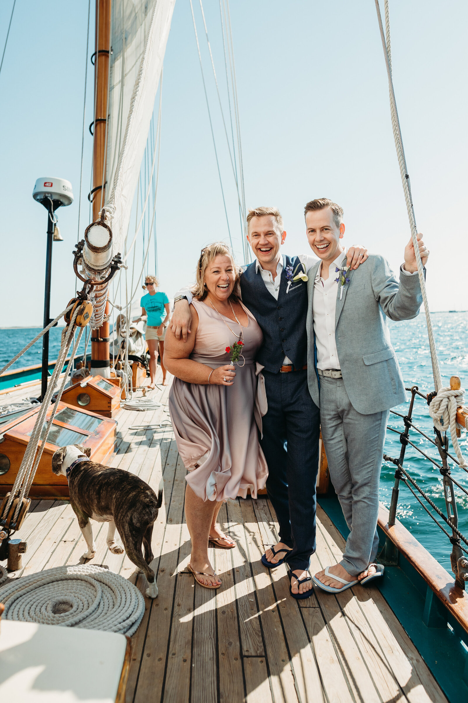 couple stands on yacht after getting married