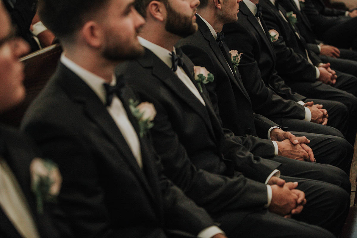 detail of groomsmen at a catholic wedding in wilmington delaware