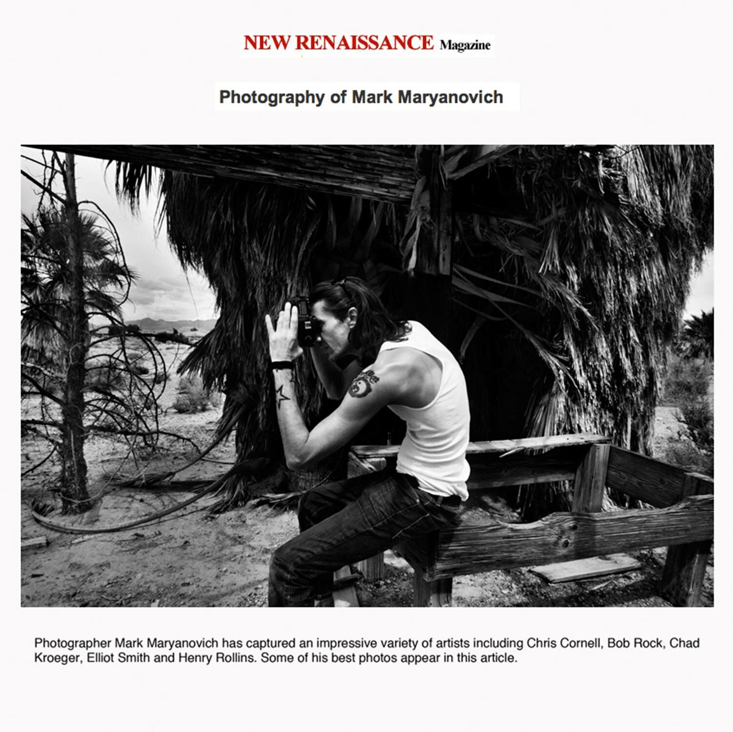 LA Photographer article Photography of Mark Maryanovich black and white behind the scenes photo looking through back of camera in desert surrounded by trees and sitting on wood structure Publication New Renaissance Magazine page 1