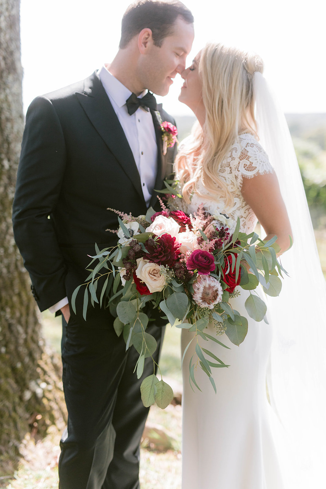 Burgundy bridal bouquet with bride and groom at montaluce winery and restaurant