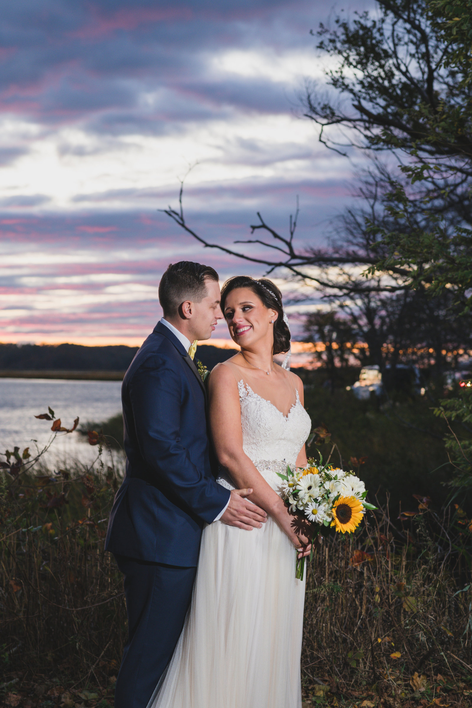 photo of bride and groom looking at each other from Three Village Inn