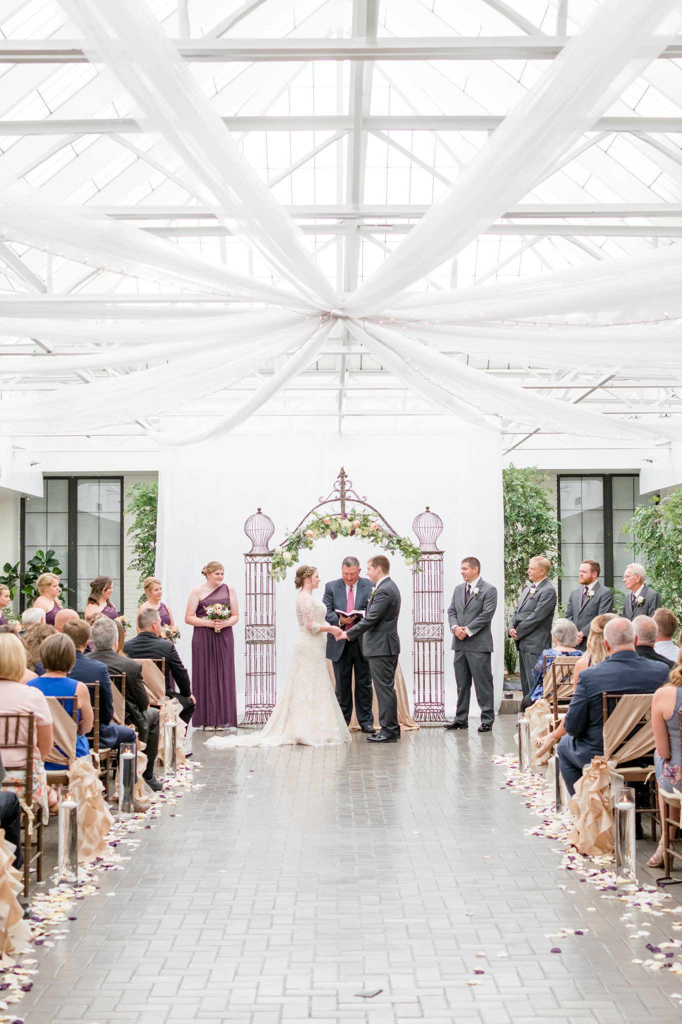 White and purple wedding ceremony