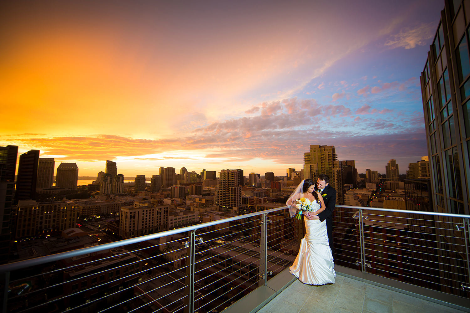 Romantic portrait with surreal sunset over the downtown San Diego skyline.