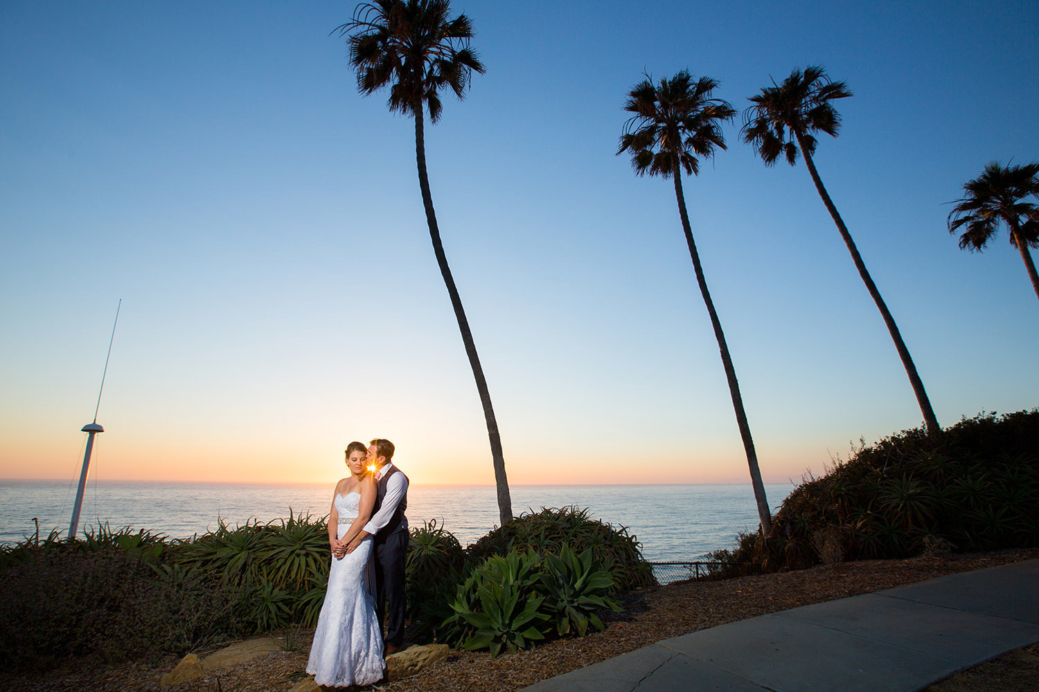 beautiful sunset picture with bride and groom at martin johnson house