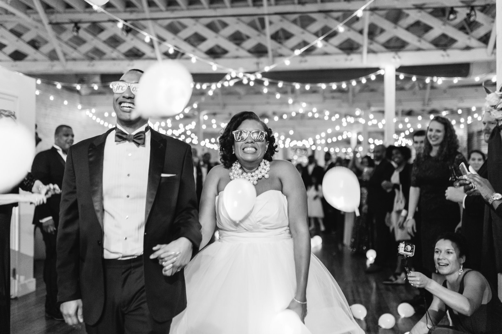 LED exit with balloons at wedding
