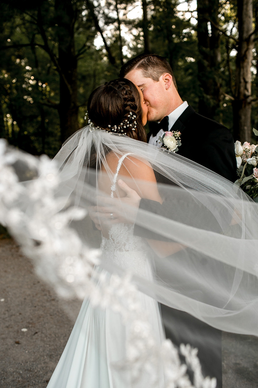 Des Moines Iowa wedding couple veil shot.