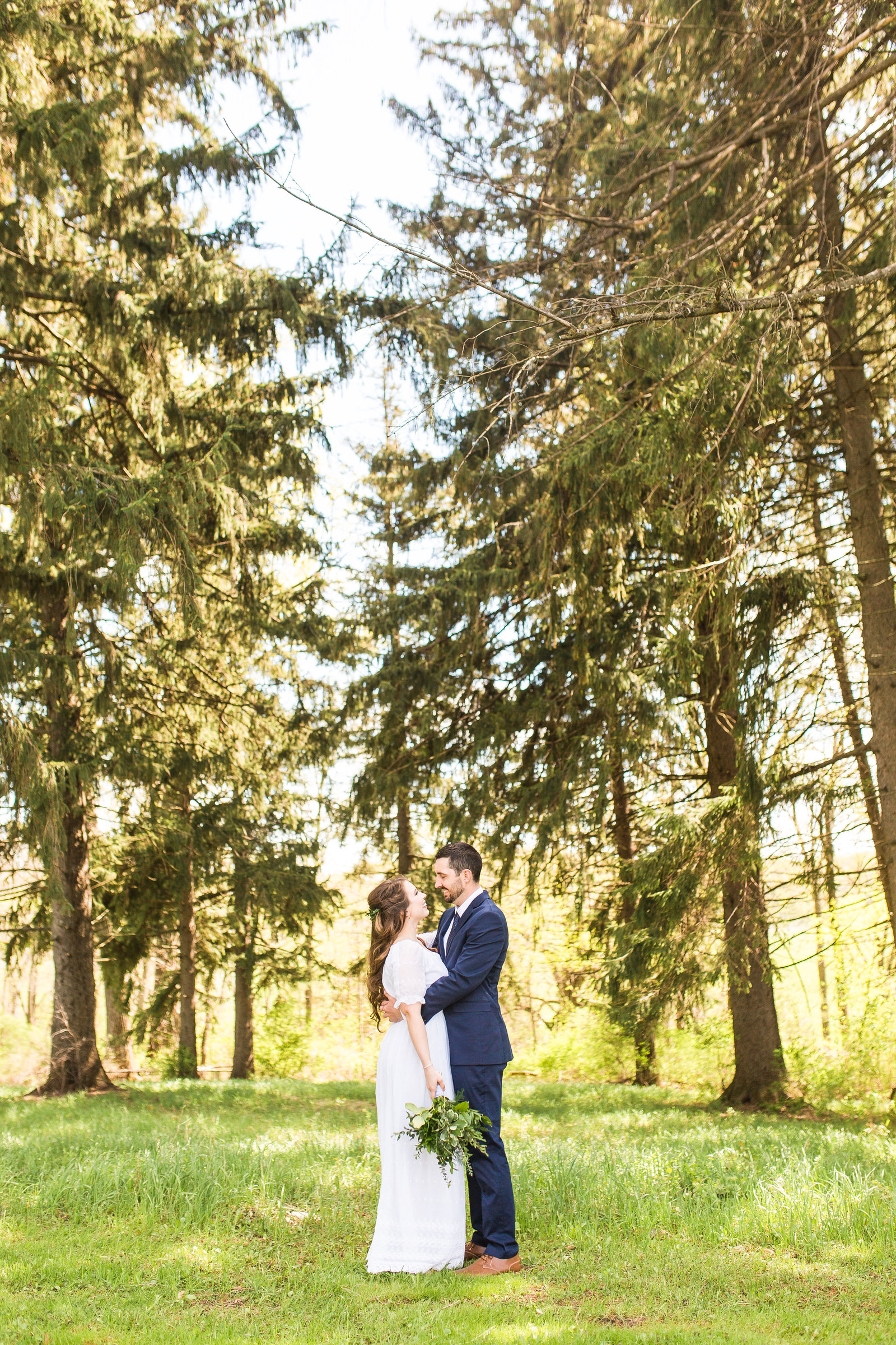 Bride and Groom portraits in the forest| Megan Snitker Photography | Iowa City Wedding Photographers