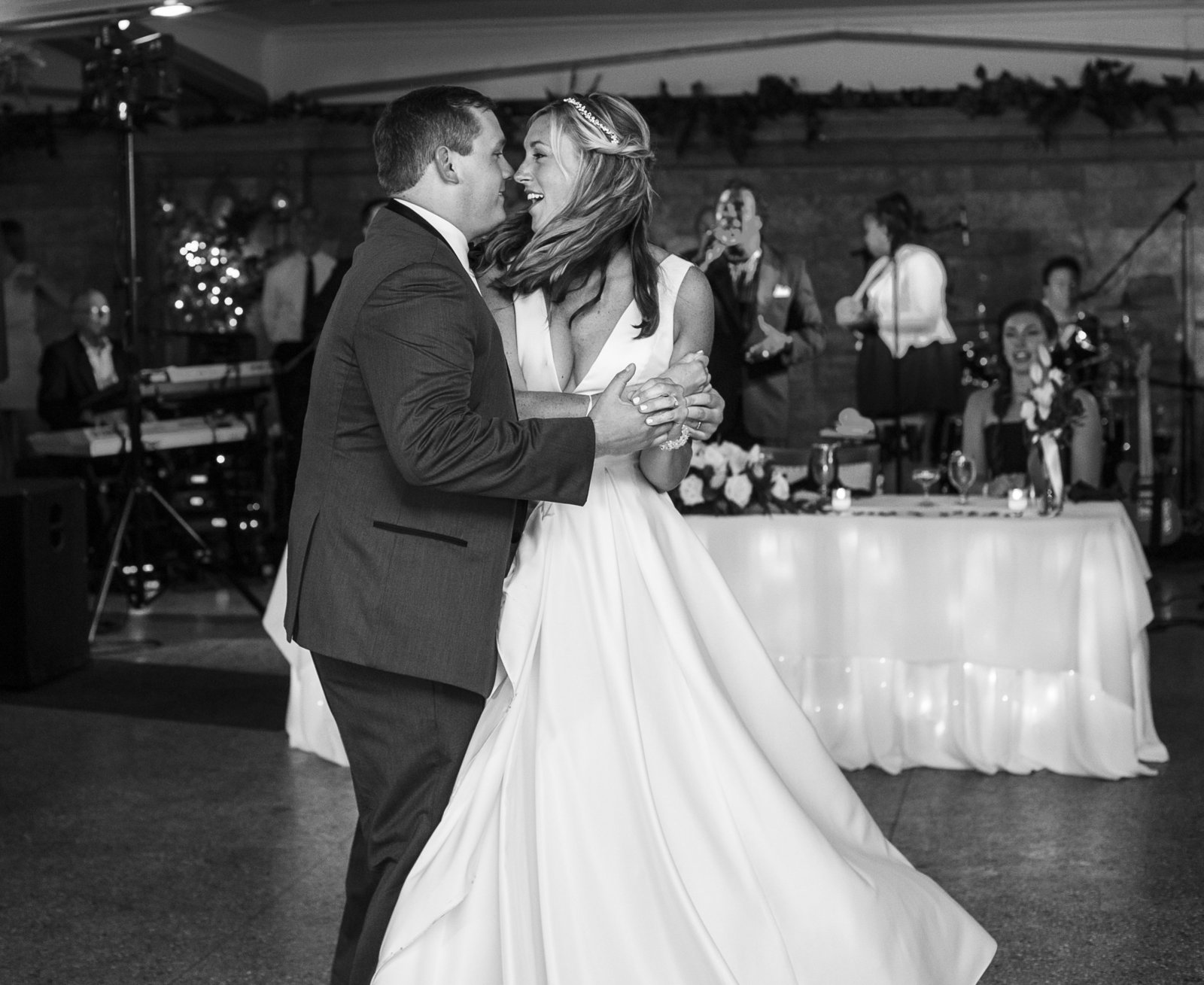Bride and groom mid twirl of their first dance at Masonic Temple wedding reception