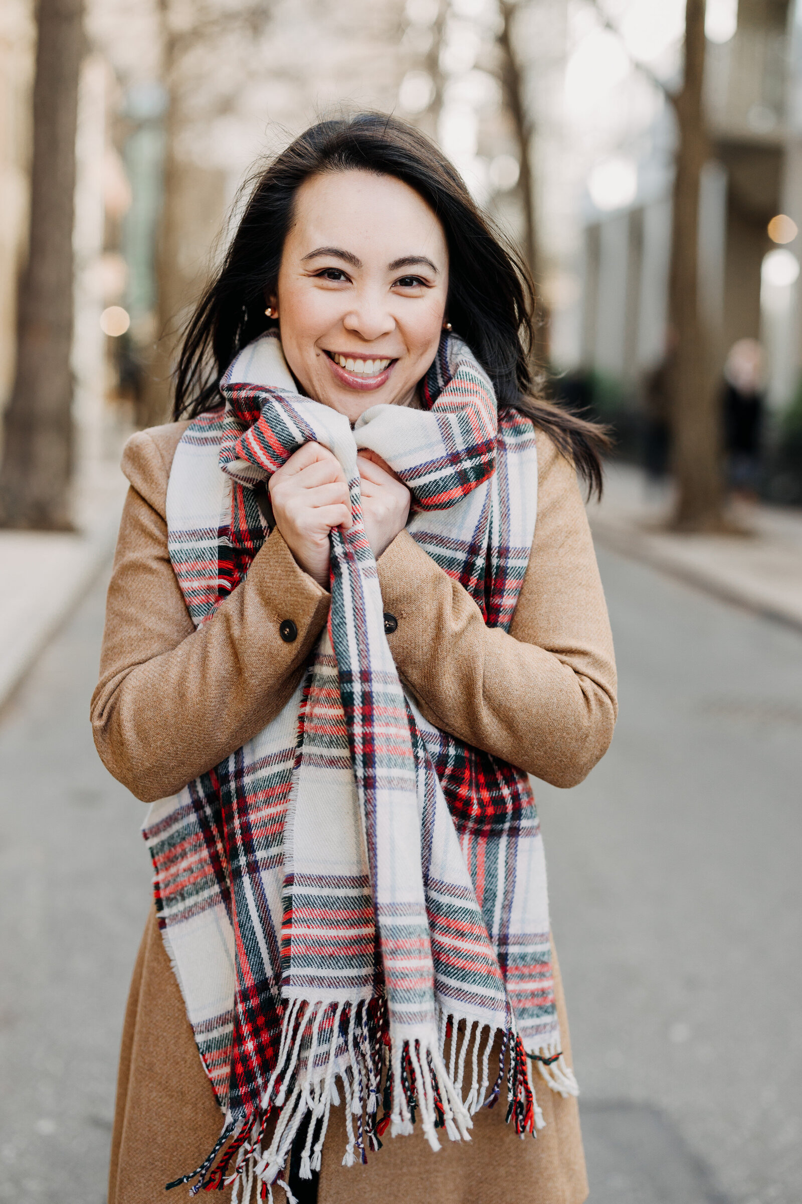 asian woman with scarf in the city