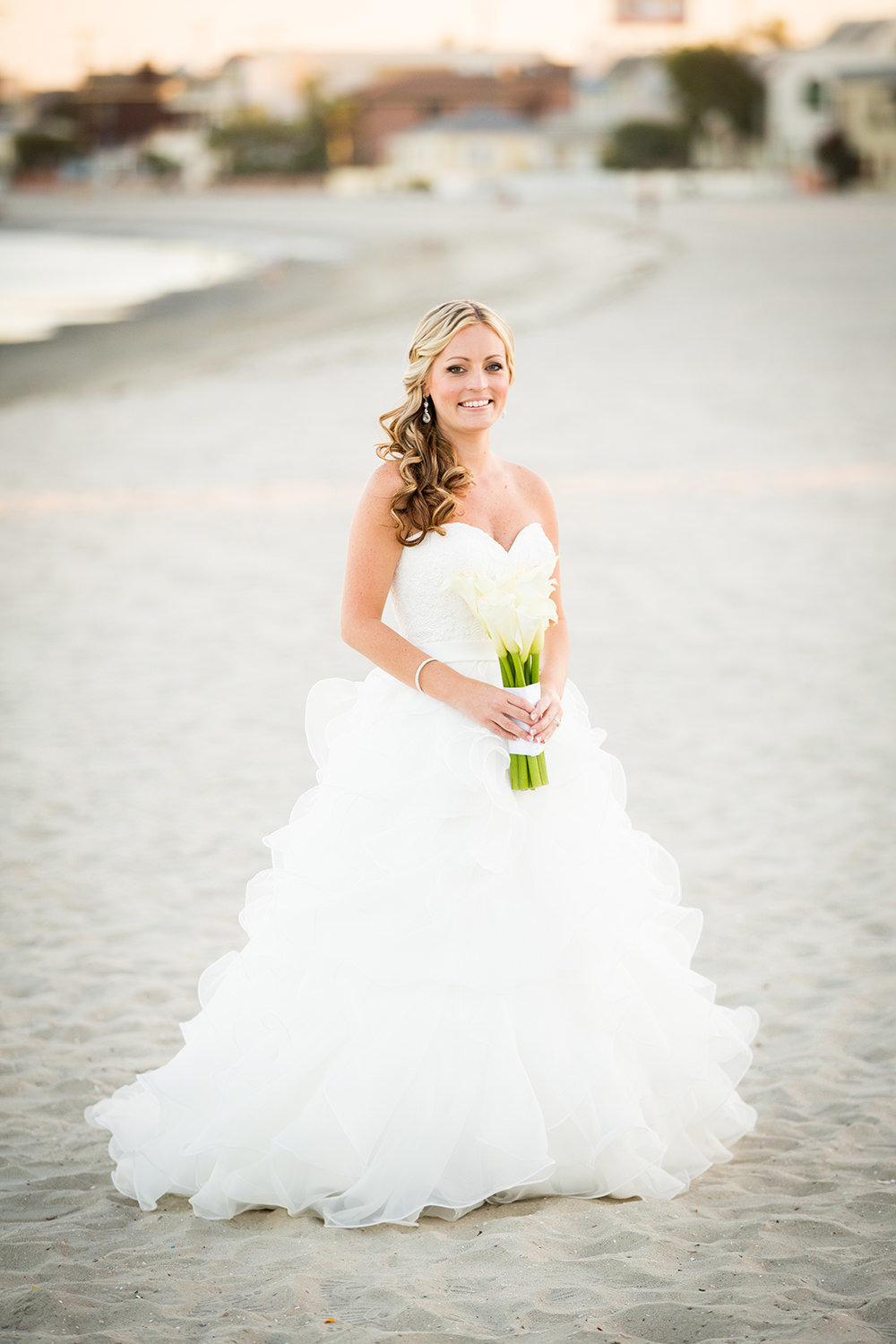 bride and beach with white flowers