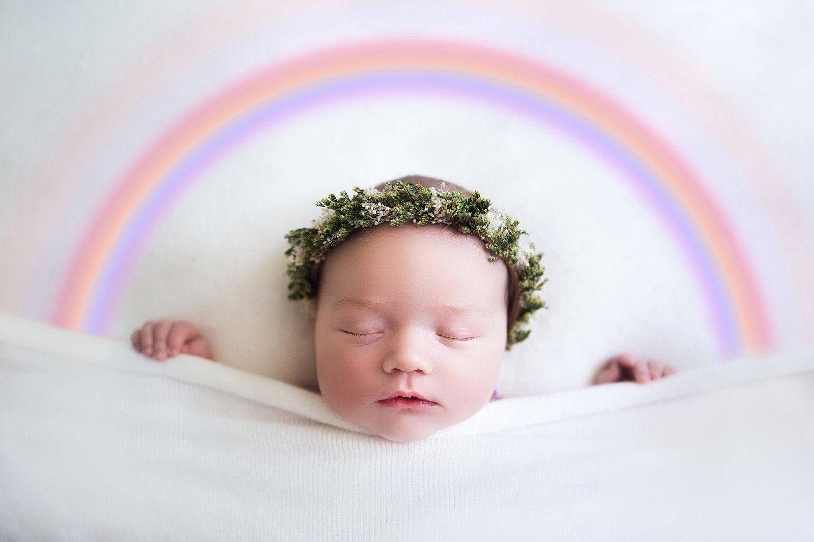 Professional studio portrait of baby asleep and rainbow