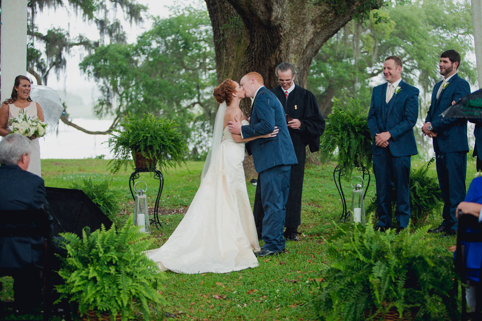 Bride and groom kiss, Old Wide Awake Plantation, Charleston, South Carolina