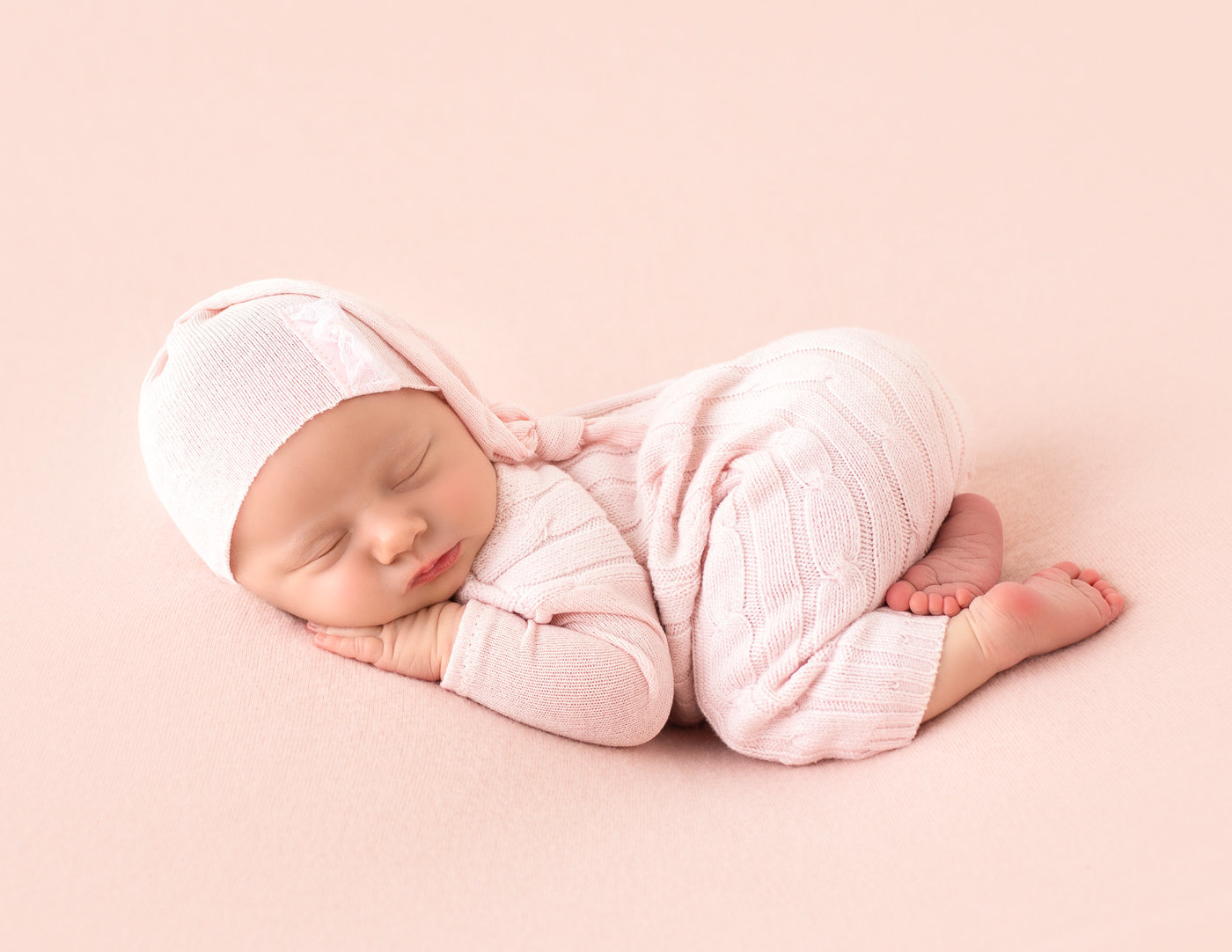 Sweet newborn girl posed in our Rochester, Ny studio.