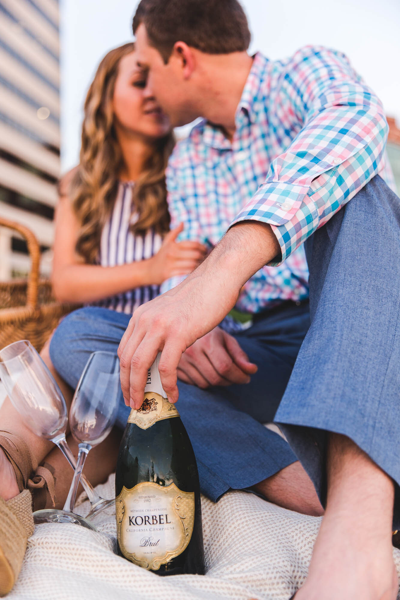 engaged-couple-kissing-with-champagne-columbus-ohio