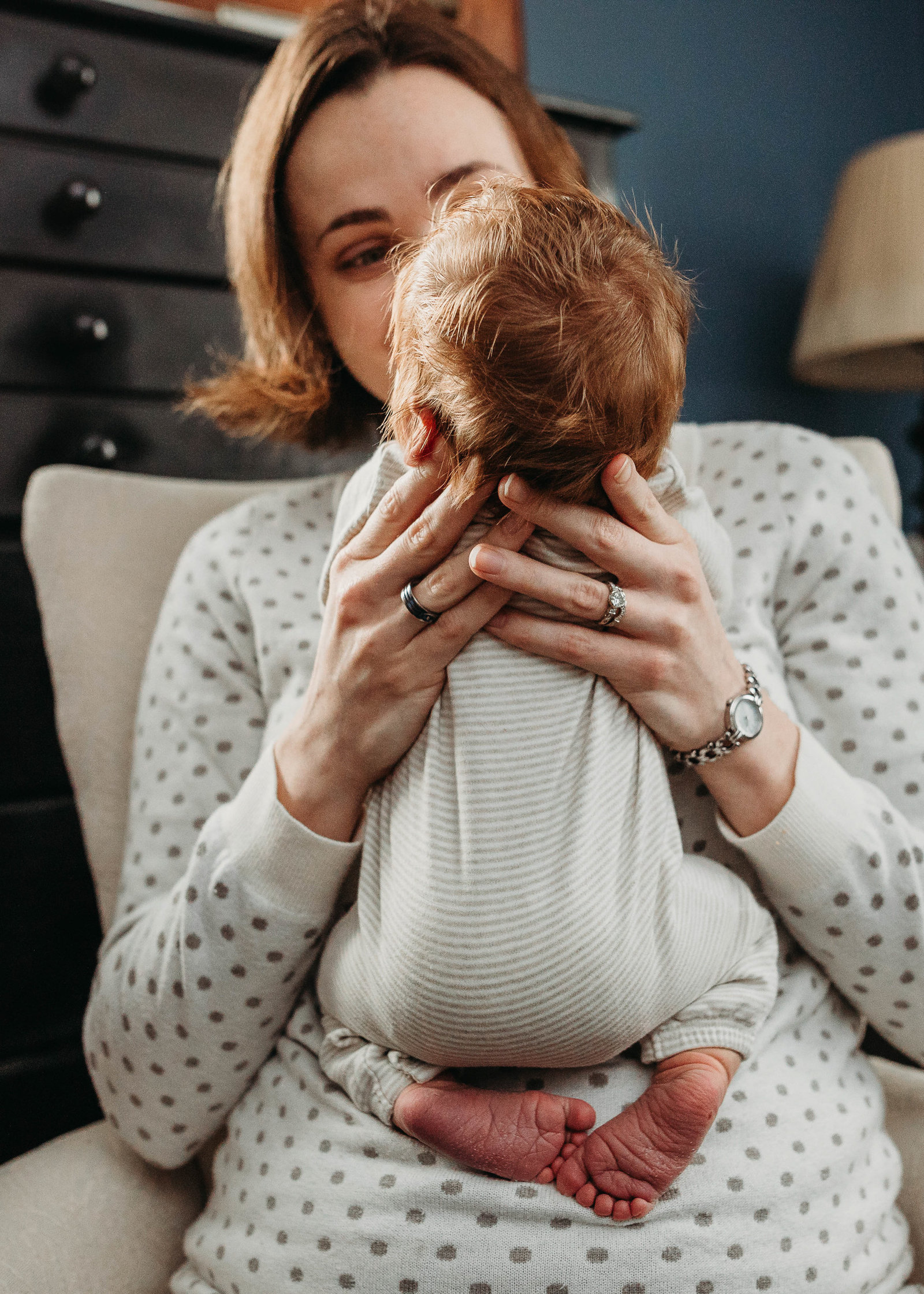 mother holds redheaded baby boy in newborn images in arlington ma