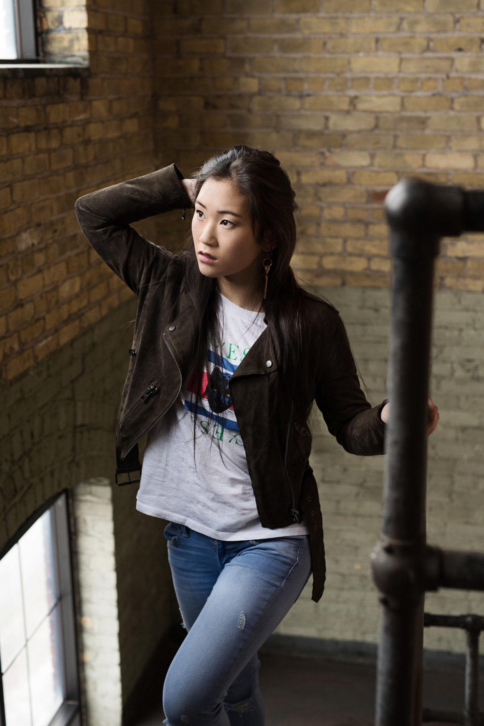 Senior picture of asian girl in urban stairway
