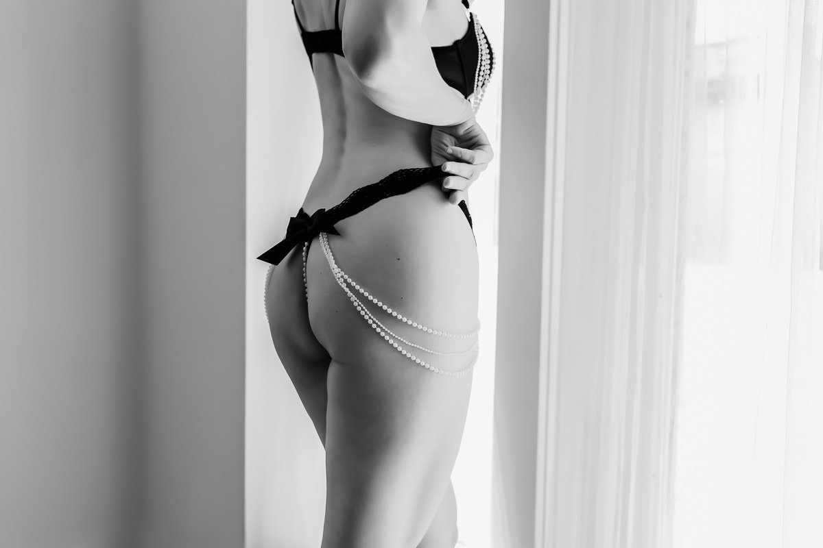 Fine art boudoir photo of a woman in black and white