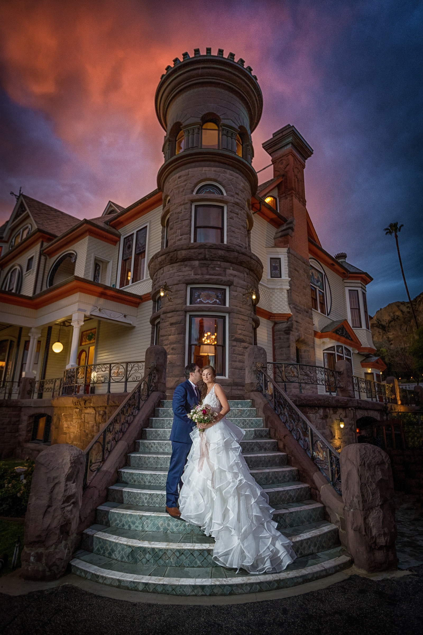 bride and groom on the front stairs of the newhall mansion
