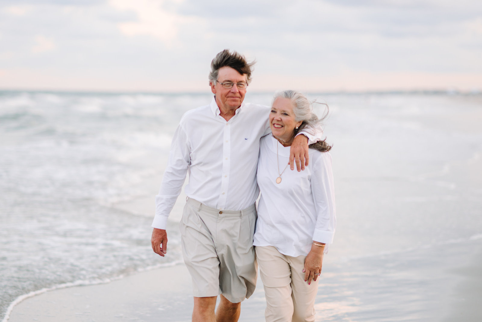 Elderly Couple Walking on the beach in Pawleys Island, SC