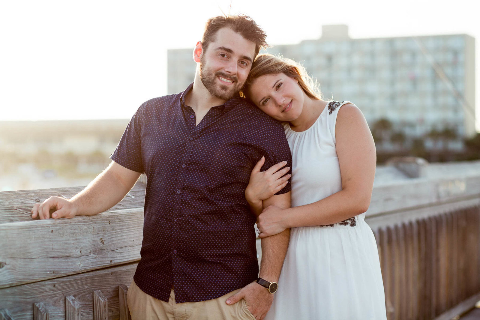 Engaged Couple at sunset on pier, Folly beach in Charleston, South Carolina