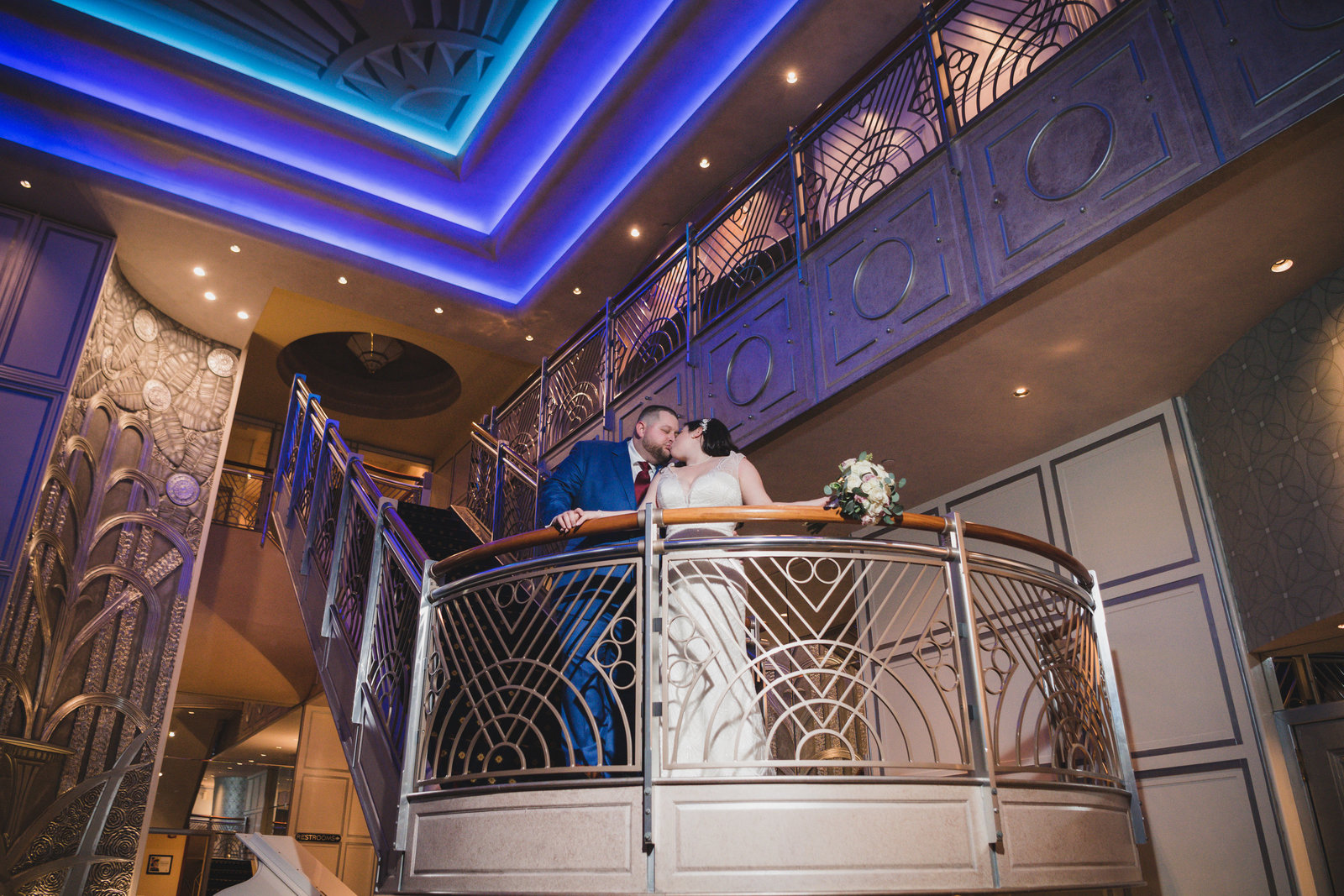 bride and groom kissing on stairs at Chateau Briand