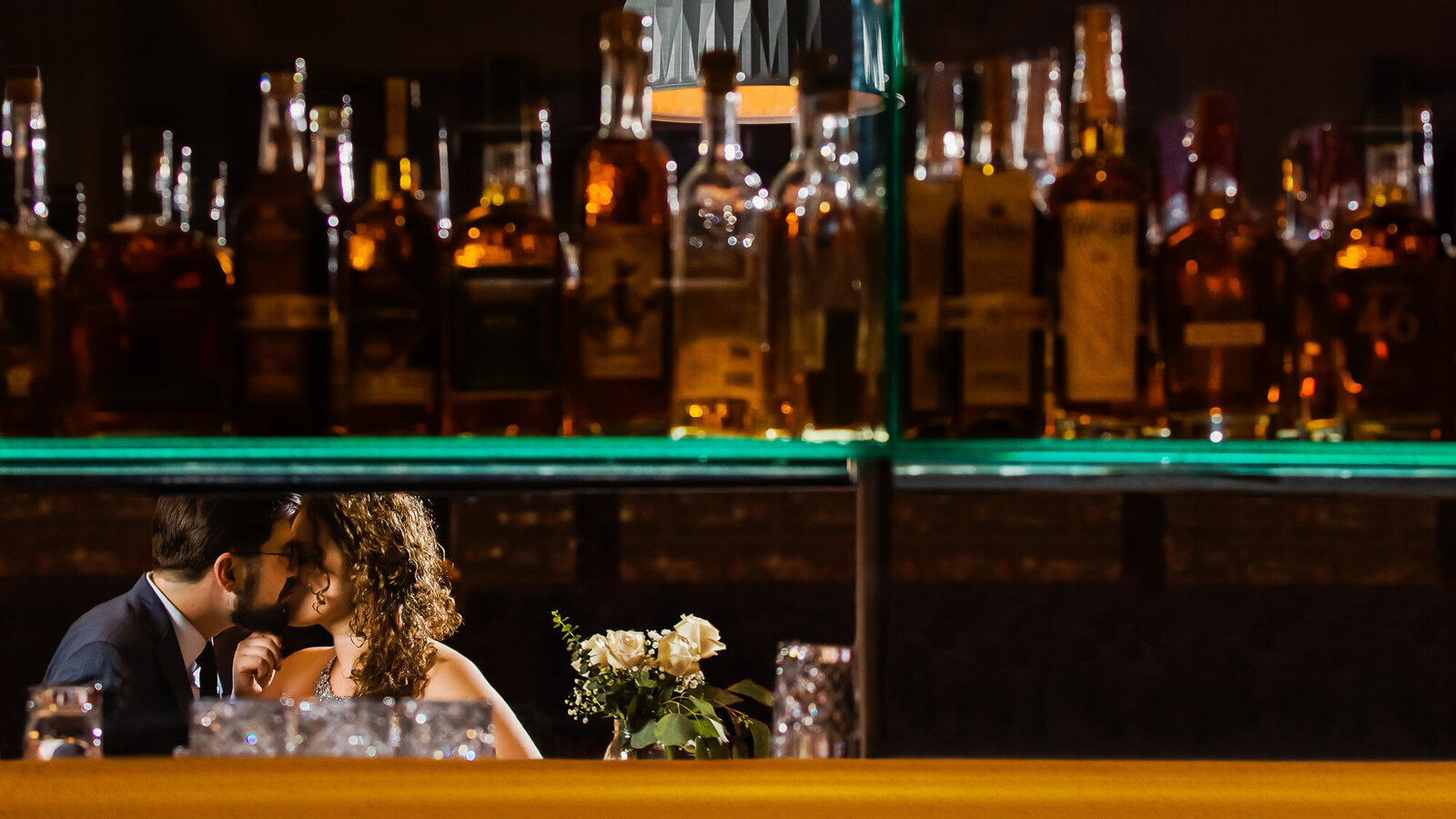 Creative wedding photo of bride and groom at the bar at their St. Louis Wedding