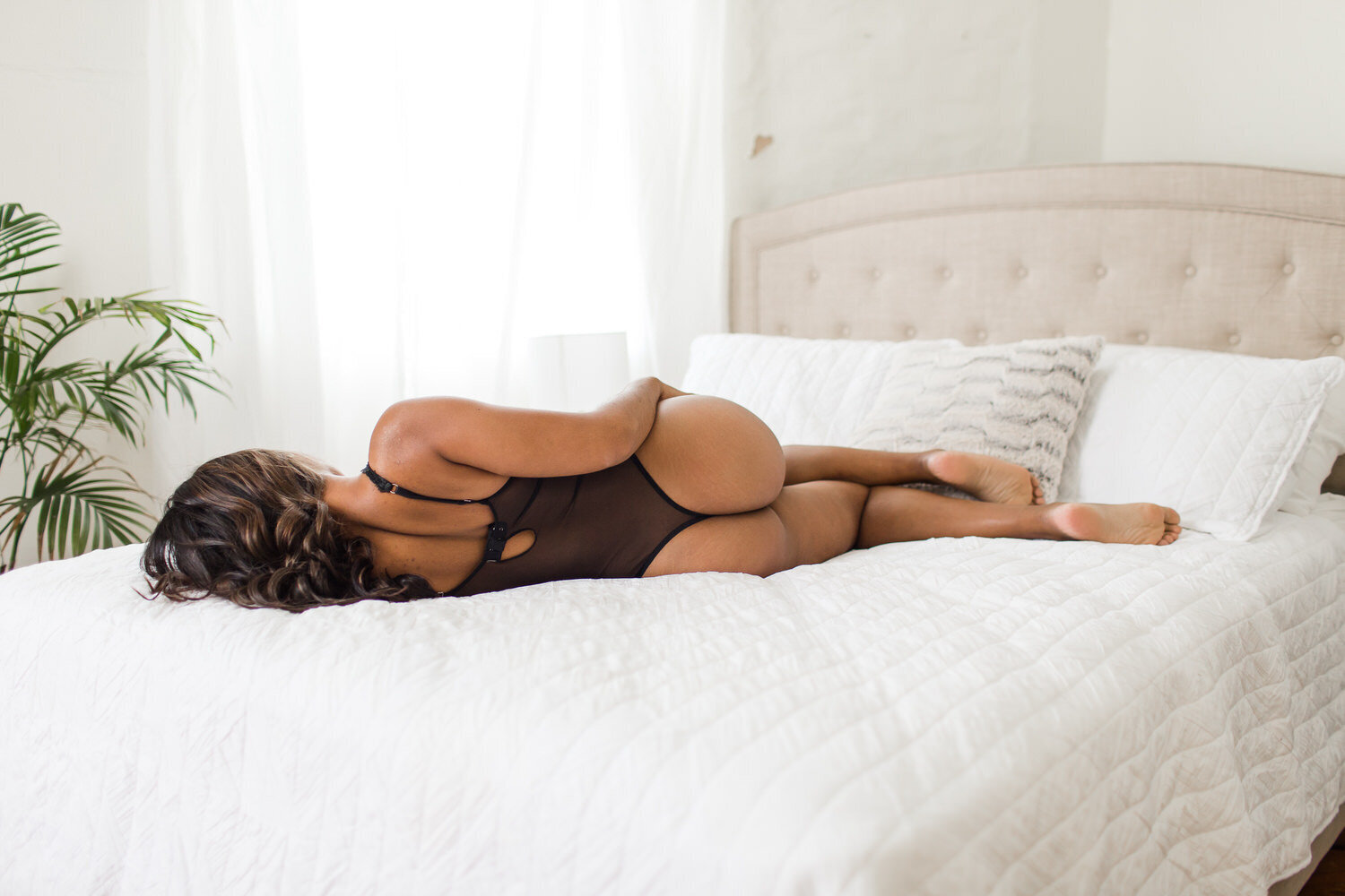 woman laying on bed in boudoir photos