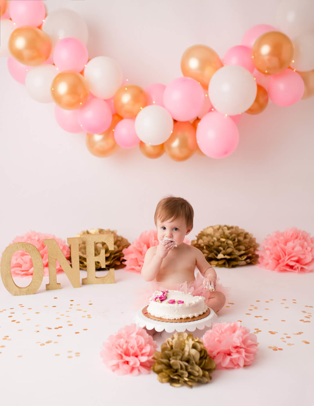 Pink and Gold cake smash in or Rochester, NY studio.