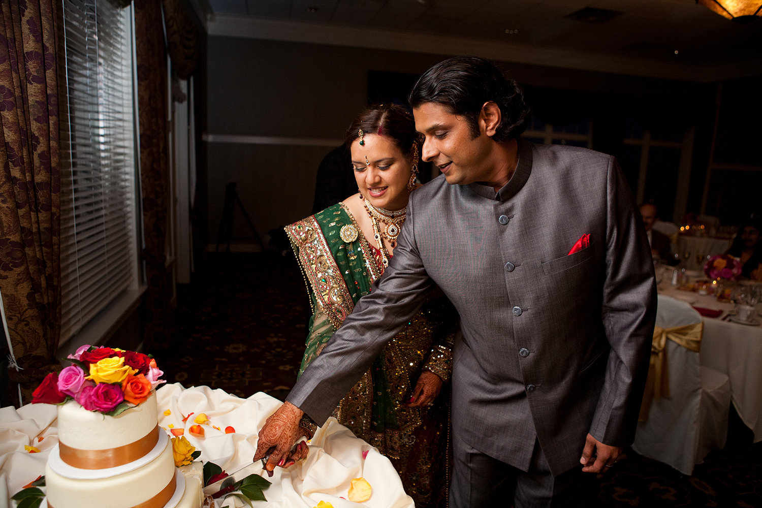 Indian bride and groom cut their cake