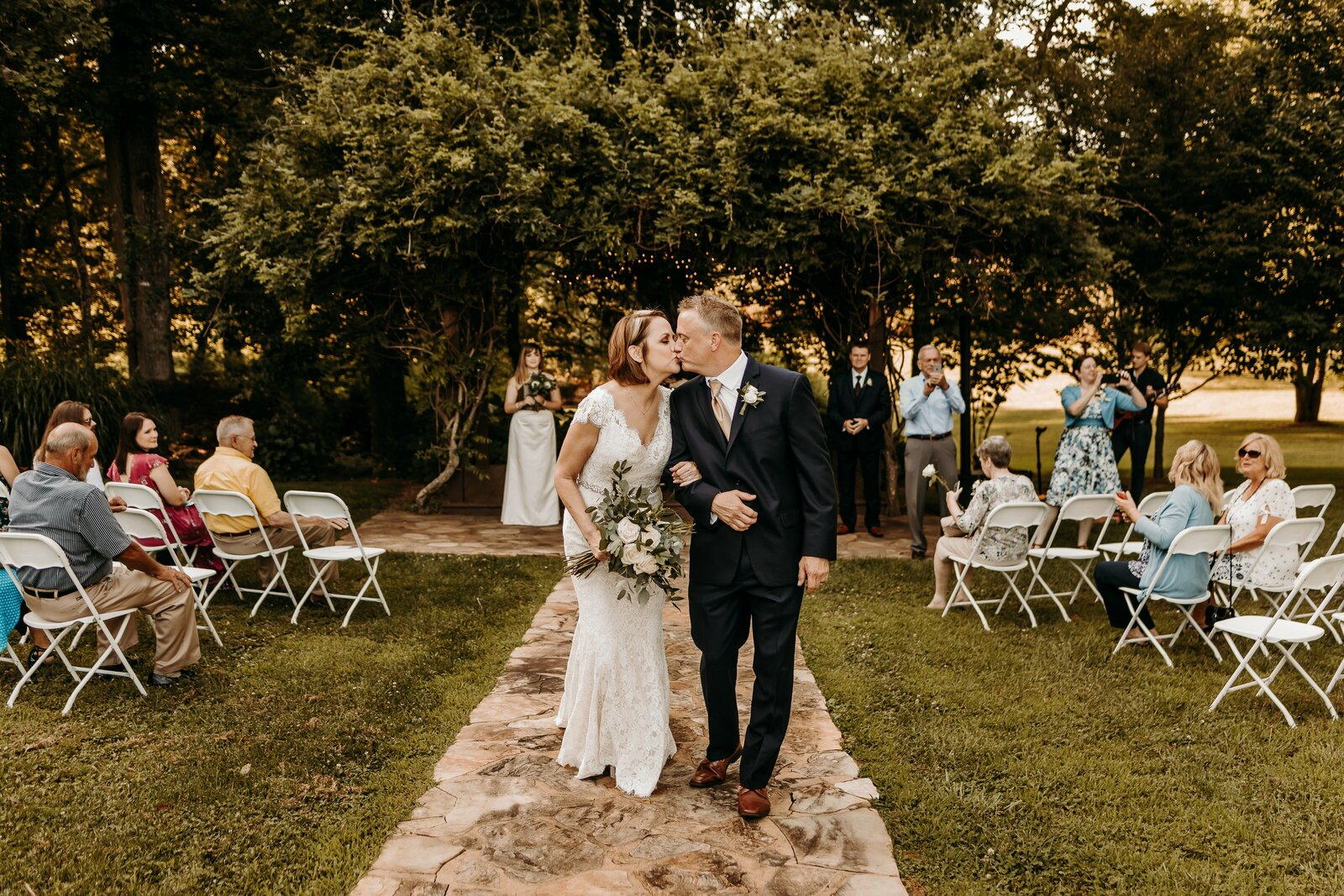 J.Michelle Photography photographs bride and groom walking down the aisle
