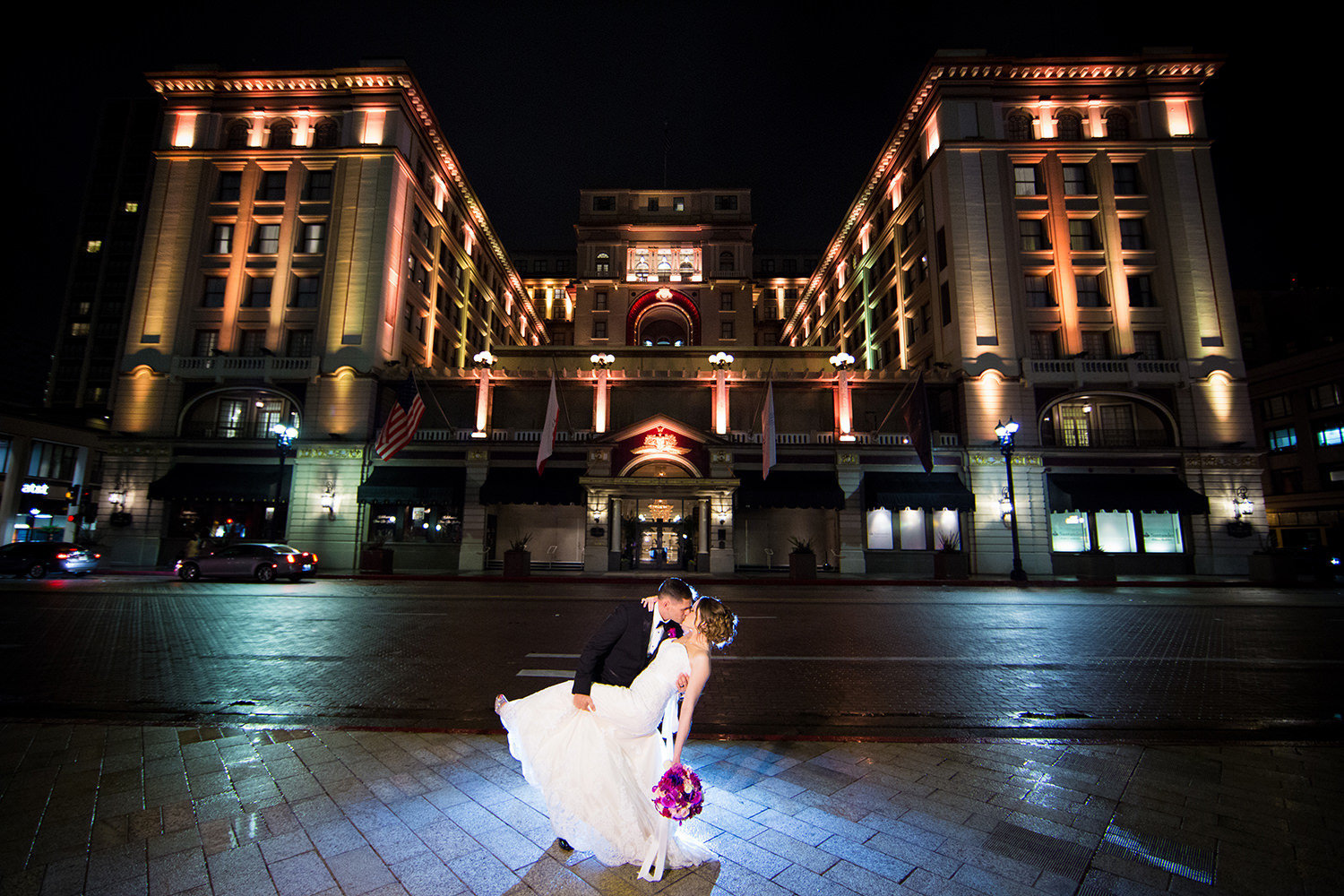 night shot with bride and groom with us grant hotel in background
