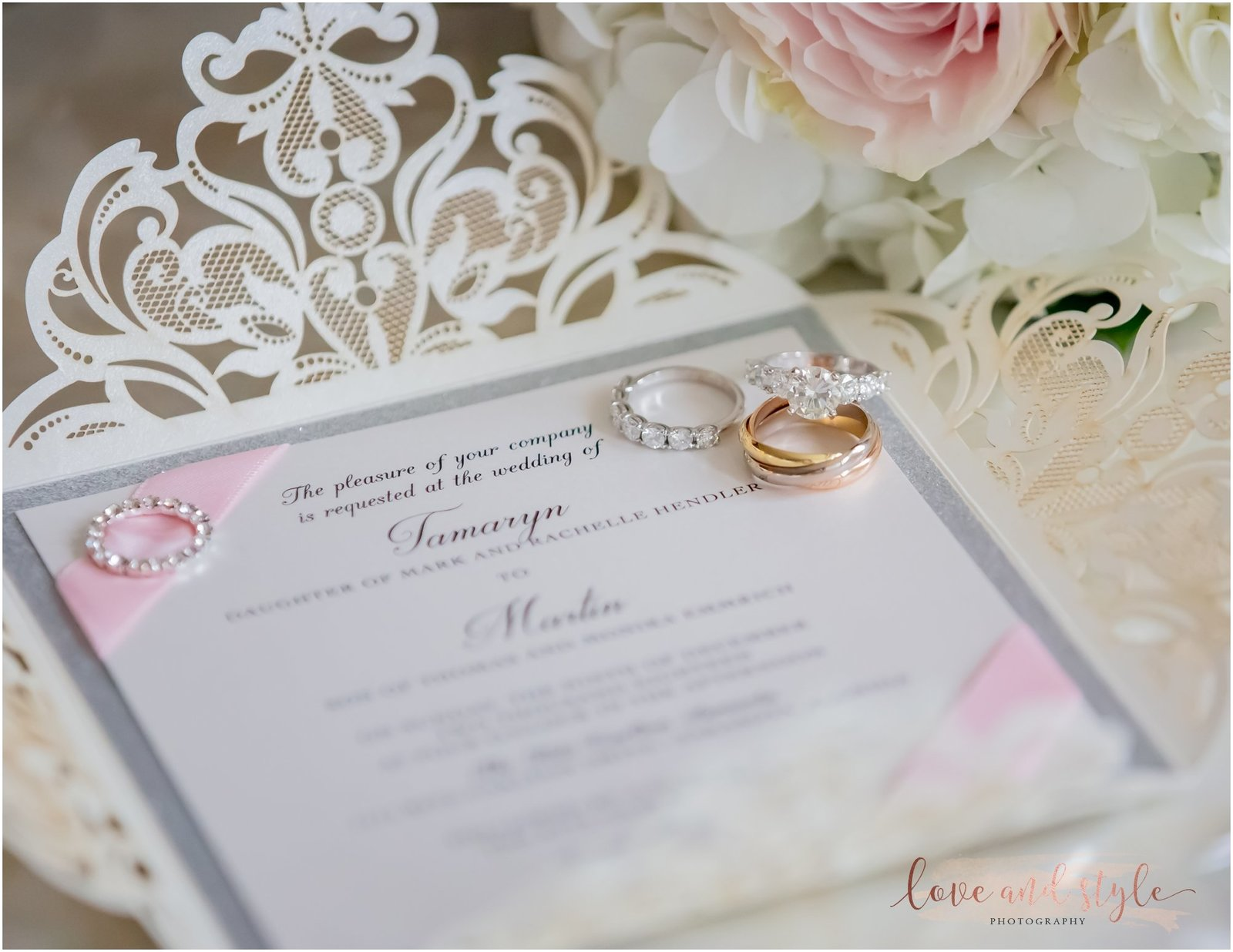 Detail shot of wedding rings and invitation suite for a wedding at The Ritz Carlton, Sarasota