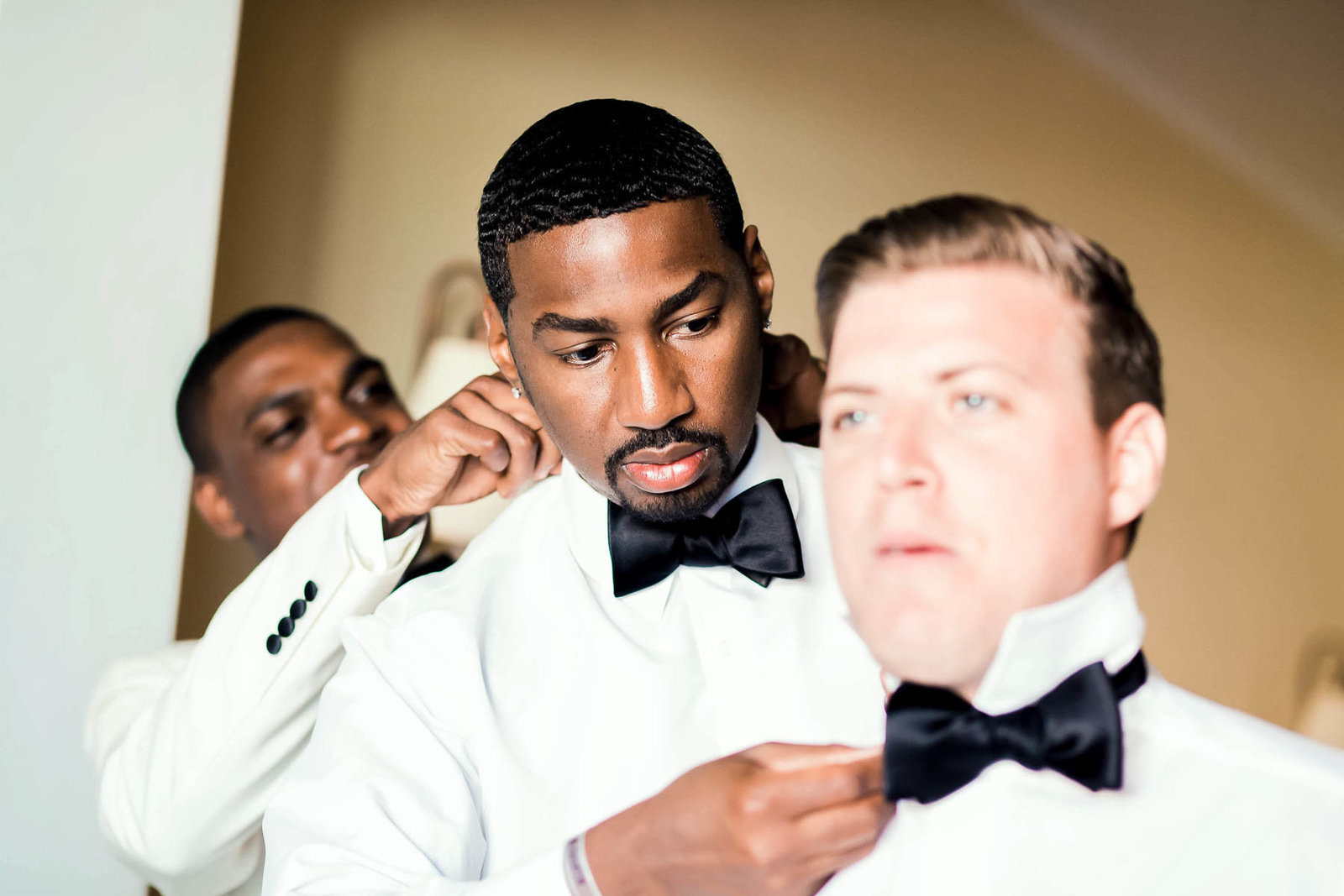 Groomsmen get suits on, Jamaican Destination Wedding, Iberostar Rose Hall Suites, Montego Bay. Kate Timbers Photography.