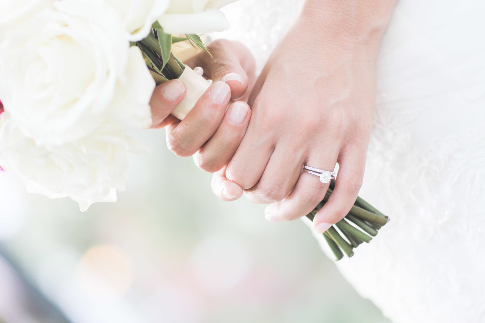 charlotte wedding photographer shot of diamond ring and bouquet
