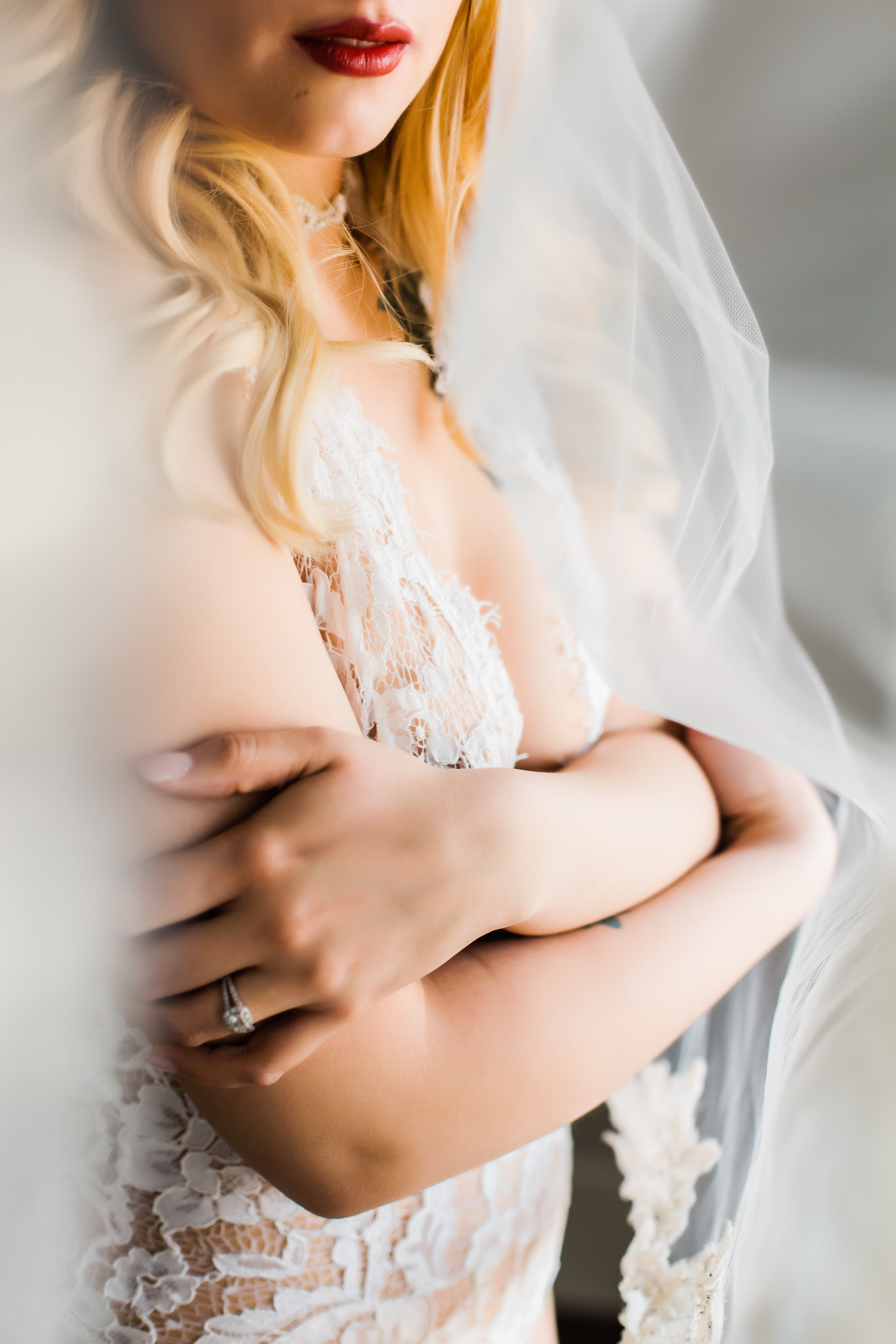 Bride wearing lingerie and a wedding veil