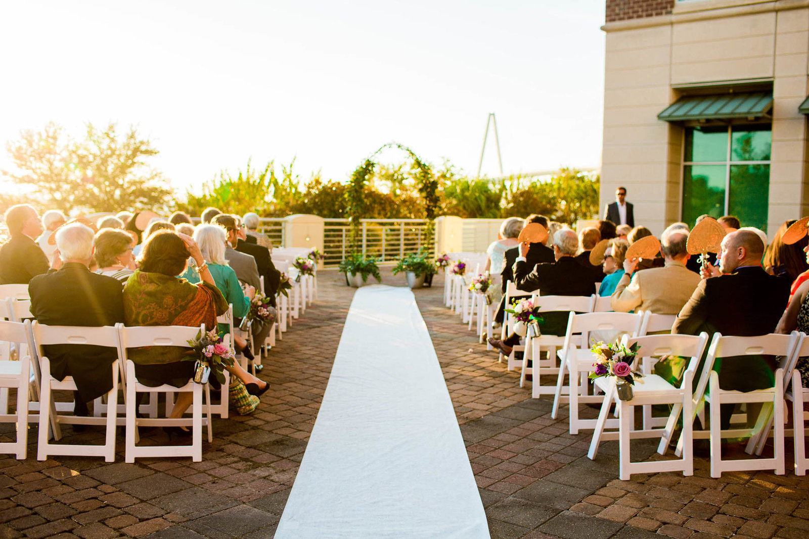 Ivy covered arch are at center of the aisle, Harborside East, Charleston Wedding Photography.