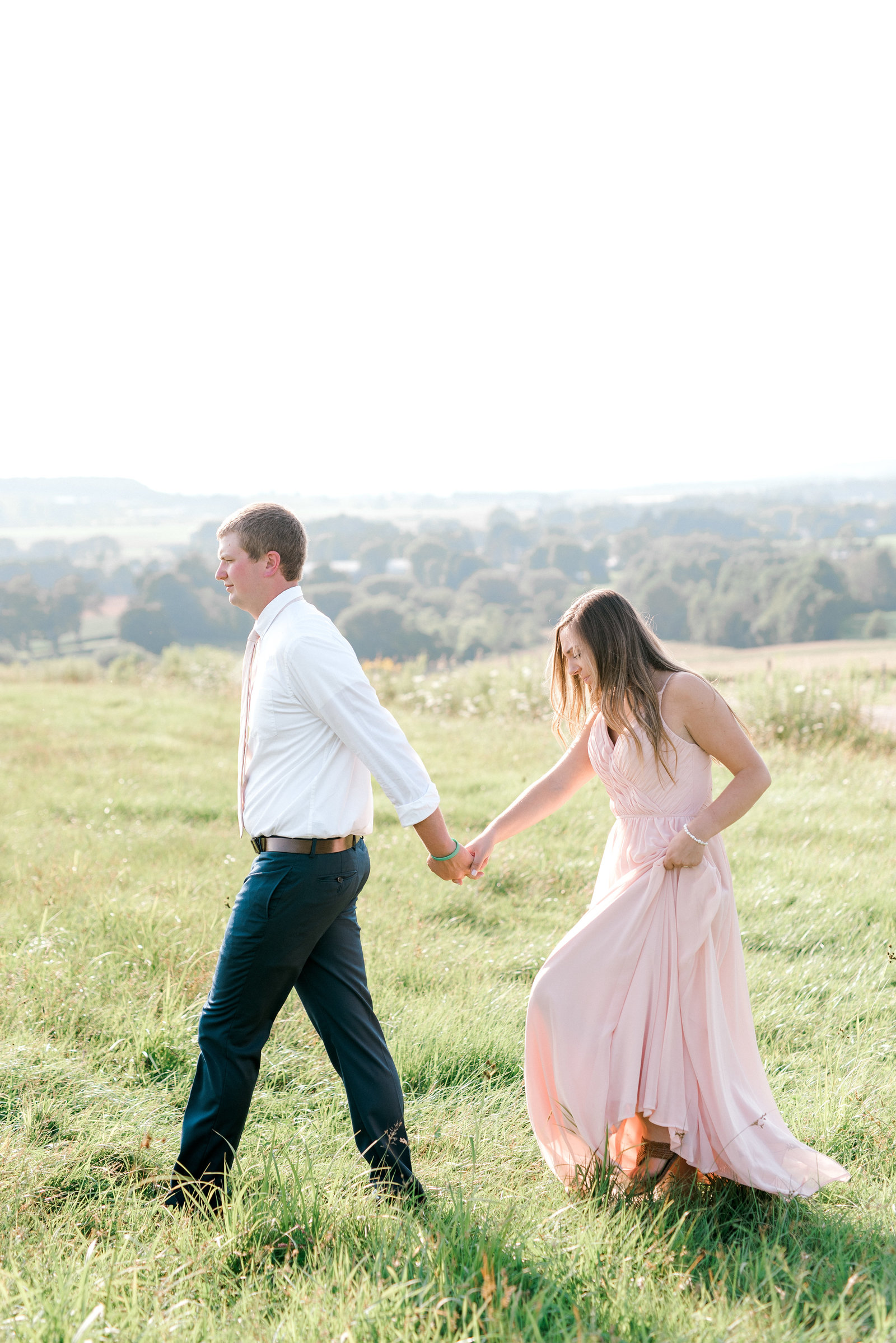 Couple Walking Through a Field in Western NY during engagement session
