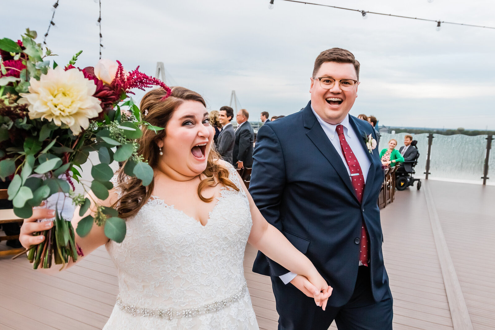 Couple celebrates after their wedding ceremony at The Caramel Room at Bissinger's in downtown St. Louis